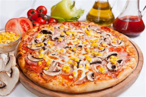 pizza milano  corn  mushrooms stock photo image