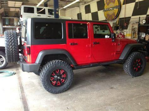 4 door jeep wrangler jacked up red rims jeeping cing pinterest doors jeeps