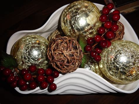 This centerpiece is made from a slice of a walnut log. My lovely daughter-in-law chose this unique bowl for my birthday. Adding a few mercury balls ...