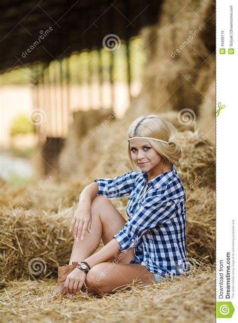 Blonde Woman Resting On Hay In Rural Areas Stock Image