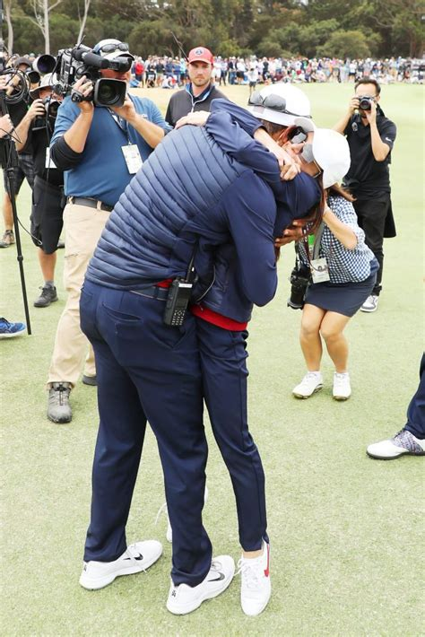 Tiger Woods and Erica Herman celebrate U.S. Team win with ...