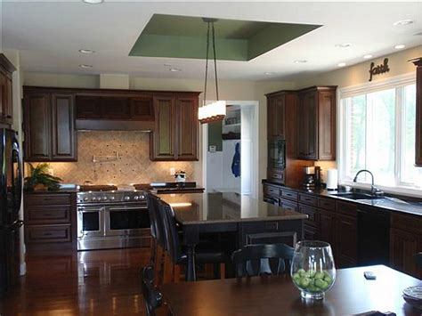 Carrie's dark wood kitchen with black island   Hooked on