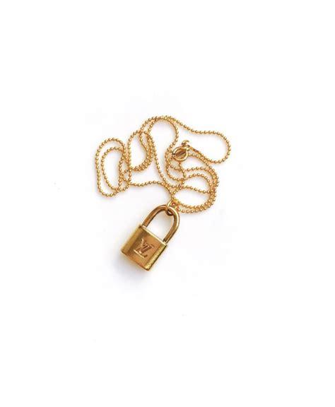 small vintage gold louis vuitton lock charm necklace  soul vintage jewelry
