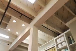 exposed basement ceiling painted laundry room ideas