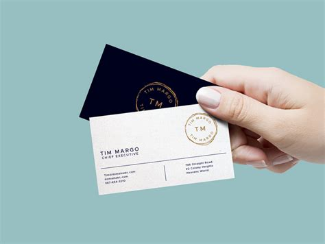 Hand Holding Business Card Mockup Free Template