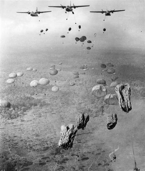 Paratroopers Are Jumping From C-123 Aircraft Over Vietnam