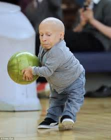 grey cardigan verne troyer scores a strike at the ten pin alley during