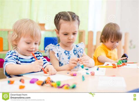 Kids Group Doing Arts And Crafts In Day Care Centre Stock