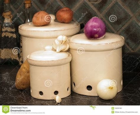 Kitchen Canisters For Potatoes,onions, And Garlic Stock