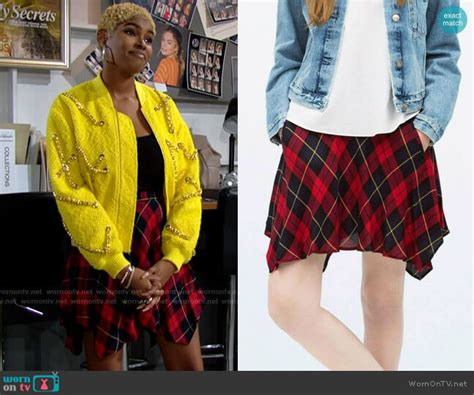 Paris's yellow chain detail bomber jacket and plaid skirt ...