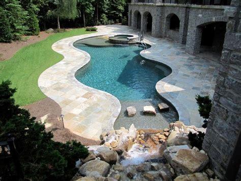 inground swimming pool  beach entry  waterfalls