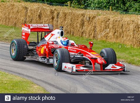 Both toyota and bmw had withdrawn from f1 and the latter handed its team back to peter sauber. 2010 Ferrari F10 with driver Marc Gené at the 2016 Goodwood Festival Stock Photo: 125654151 - Alamy