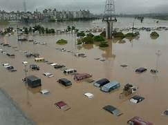 by flood waters in rem...Natural Disasters Floods
