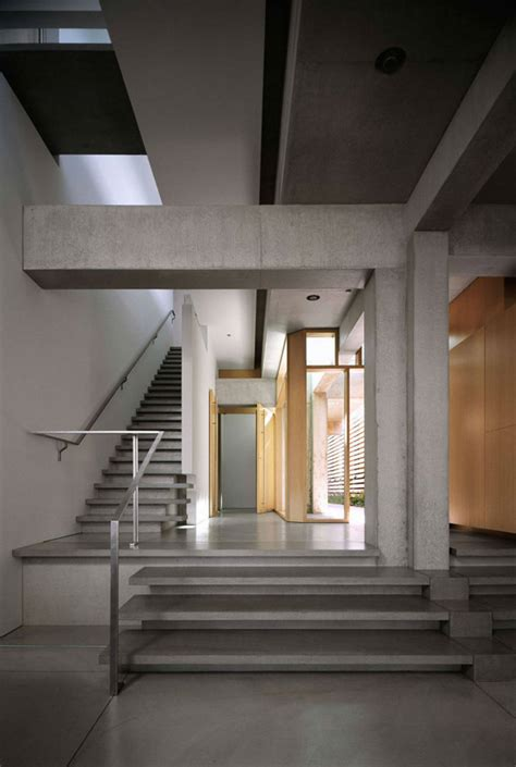 Cavernous Cool Interior by Cool Concrete House With Swimming Pool Feature Above