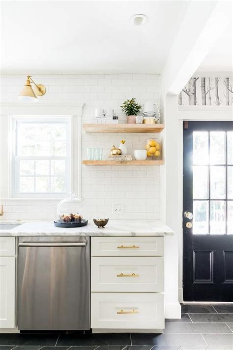 white  gold kitchen  stacked wooden floating