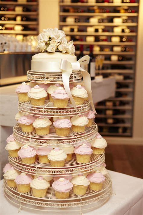 cupcake wedding cake    tier cake top cupcakes
