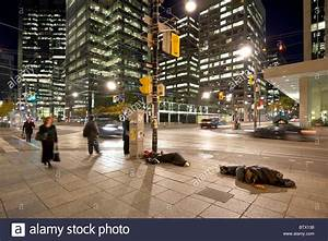 Homeless Sleeping In The Street In The Early Morning In ...