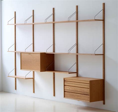 mid century wall shelf royal system shelving designed by poul cadovius in 1948