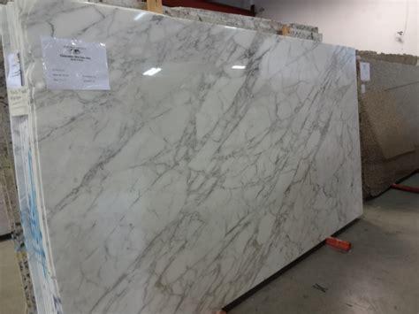 calacatta oro supreme omicron granite tile
