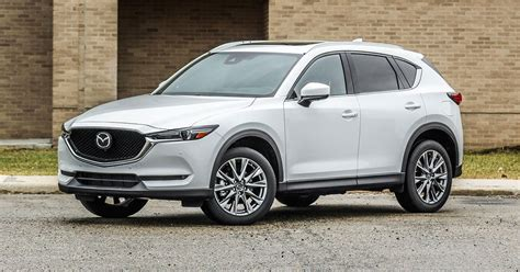 mazda cx  adds premium style   signature trim