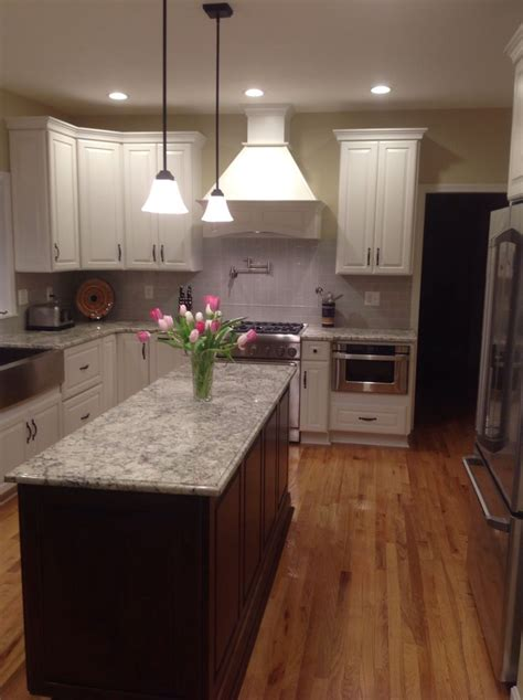 white ice granite  cherry cabinets kitchen cabinets