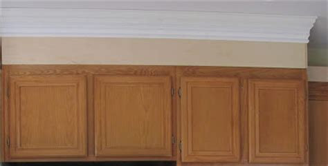 crown molding for kitchen cabinet tops adding height to your kitchen cabinets 9520