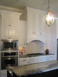 Curved range hood transitional kitchen benjamin for What kind of paint to use on kitchen cabinets for nature wall art decor