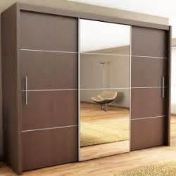 modern bedroom with inova sliding wood closet doors
