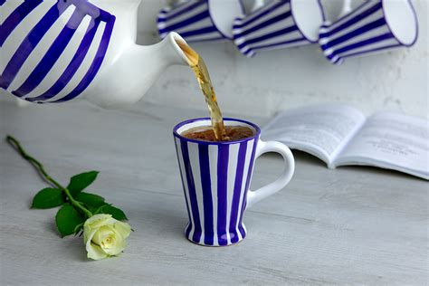 The surface of some products, including concrete and ceramic lines, has been designed to look aged and a bit rough and uneven. Dark Navy Blue Striped Handmade Hand Painted Ceramic Coffee Tea Latte Mug with Large Handle ...