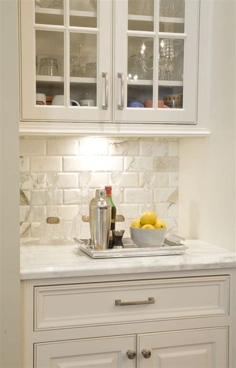 beveled calcutta marble subway tile in style home