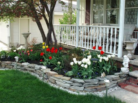 front yard flower bed did this stone wall on one side in front already trying to choose flowers shrubs now front