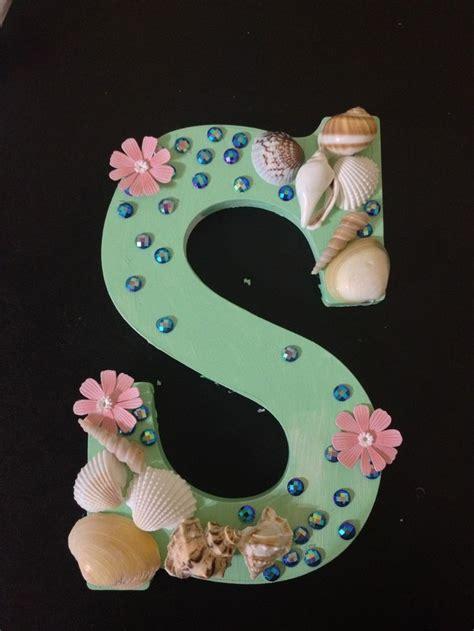 sea shells   flowers  wooden letters