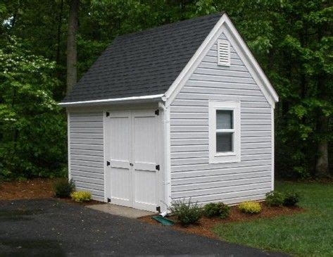 grey storage shed with white trim garages and workshops