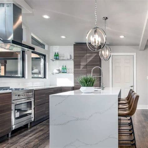 Check out some lighting ideas over the kitchen counter that gives lighting effect and set of mood as either the focus point of the kitchen or great lighting modern white kitchen with wooden pendants. Top 50 Best Kitchen Island Lighting Ideas - Interior Light Fixtures