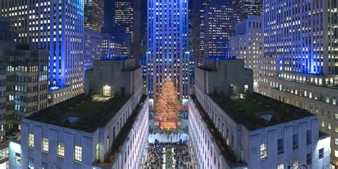 restaurant with view of christmas tree at rockefeller in new york city at rockefeller center