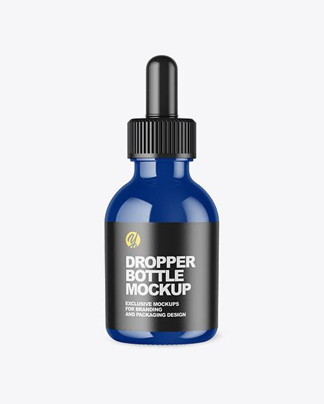 Sample design is not included in the download file. Glossy Dropper Bottle Mockup in Bottle Mockups on Yellow ...