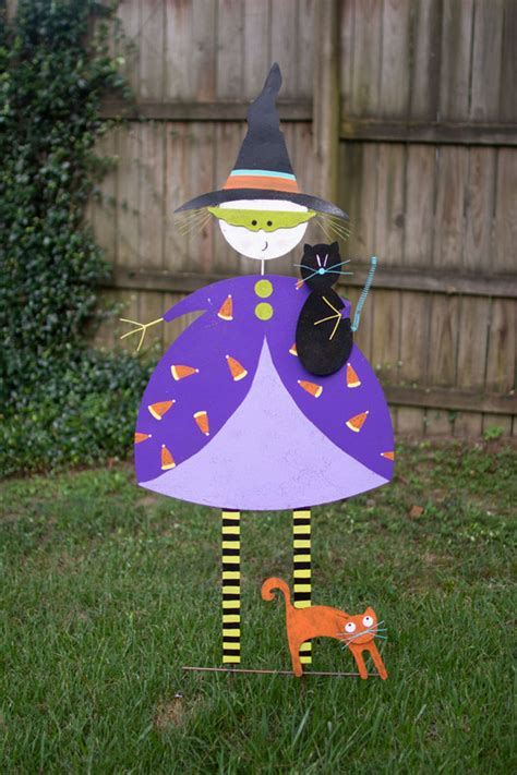 painted metal witch  cats yard stake