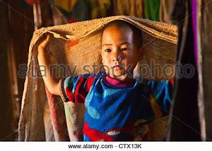 A Young Child in Traditional Tribal Attire Give the ...