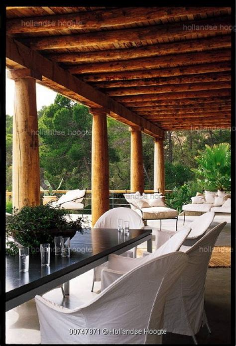 wooden veranda  distinctive wooden pillars  wooden roof structure references