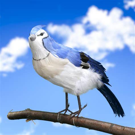 large artificial blue jay bird birds butterflies