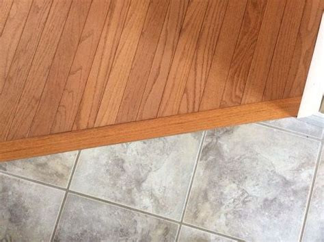 wood flooring how to transitioning hardwood floor to tile floor is there a better way hometalk