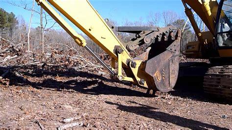 lowering  manual excavator thumb youtube