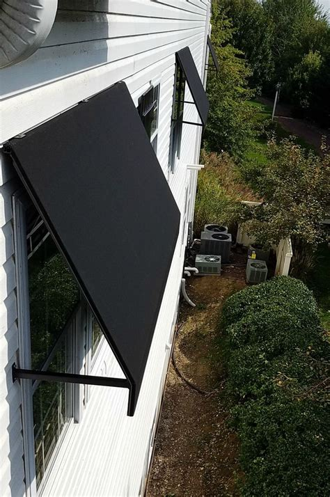 commercial awning welded frame window awning leola village black sunbrella outdoor