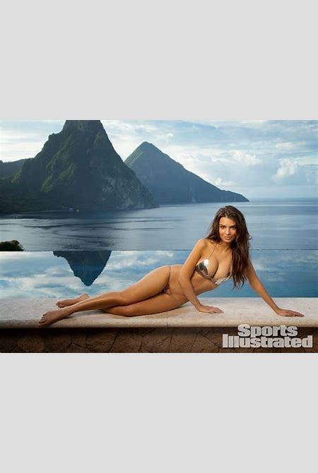 Emily Ratajkowski shows off body paint bikinis for the Sports Illustrated 2014 Swimsuit Issue