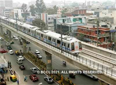A metro train leaves the Sector-15 station in Noida on the ...