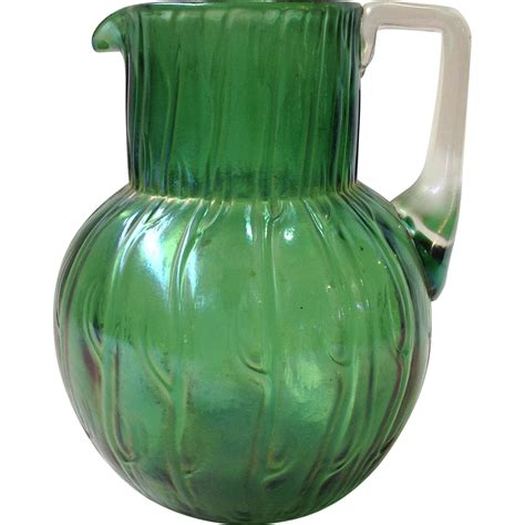vintage green glass l loetz neptune green glass pitcher antique from