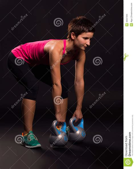 woman kettlebell weights kettlebells exercising young background preview