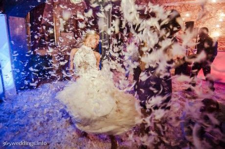 Feathers on the dance floor at Russian wedding of Julia