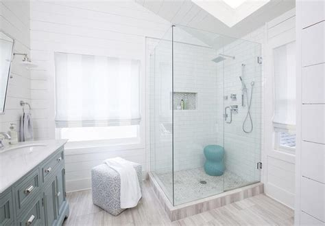 corner glass shower  marble herringbone shower floor contemporary bathroom