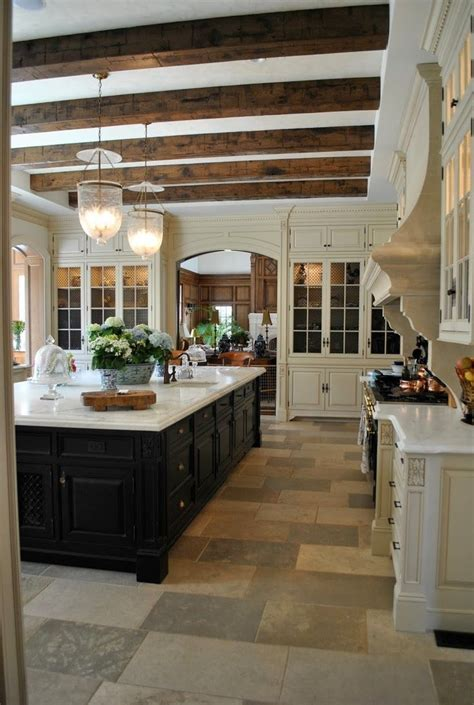 amazing kitchen islands the beams in this kitchen are amazing along with the black 1223